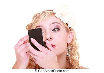 Wadding day. Beautiful bride looking in mirror, preparing to...