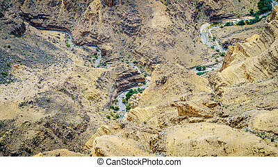 View of river bed at the bottom of Wadi Gull in Oman. View from Jebel Shams.