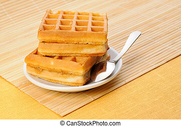Wafers - Fresh sweet wafers on saucer. With space for text