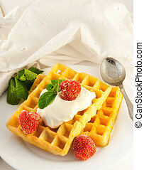 Wafers with a strawberry, cream and mint, a tasty dessert