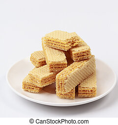 Wafers with cream on white background