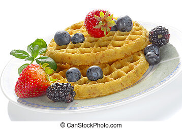 Waffle and fruits served for breakfast studio isolated on...