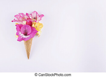 Waffle cone with composition of flowers.