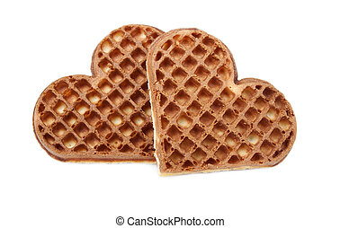 Waffle cookies in the form of hearts on a white background.