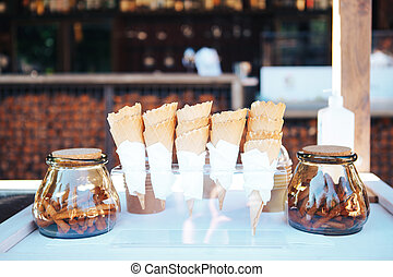 Waffle cups for ice cream. Glass jars with cinnamon sticks