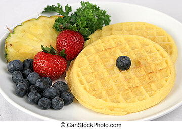 Waffle & Fruit Plate - Waffles served on a white plate with...
