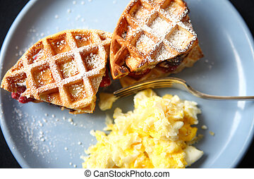 Waffle fruit sandwiches with scrambled eggs