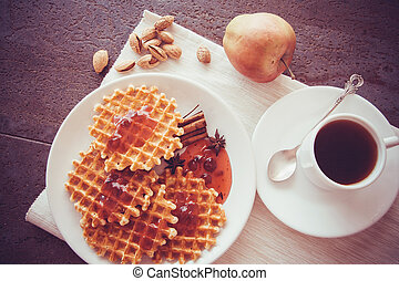 waffle with berry jam and coffee srved on table
