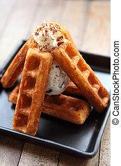 waffle with ice cream on wood background