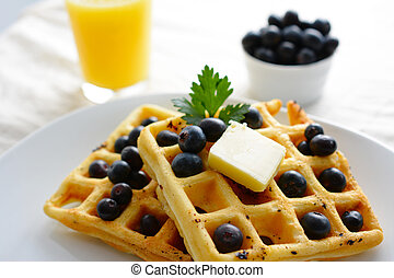 Waffles - A breakfast setting of delicious waffles in the ...