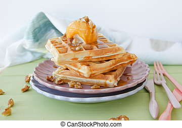 Waffles with ice cream, caramel sauce and walnuts