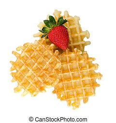 Waffles and strawberry isolated on white background.