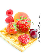 waffles, apricot, cherries, strawberries and raspberries isolated on white