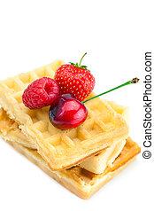 waffles, cherries, strawberries and raspberries isolated on white