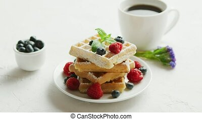Waffles on plate and cup of coffee - Fresh baked waffles on...