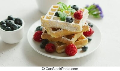 Waffles on plate and cup of coffee - Fresh baked waffles on ...