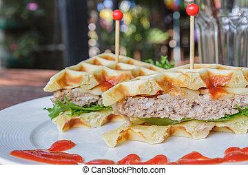 Waffles pork - Hamburger made with waffles and pork on white...