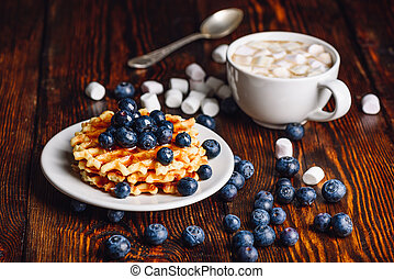 Waffles with Blueberry and Cup of Hot Chocolate.