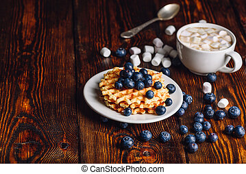 Waffles with Blueberry and Hot Chocolate.