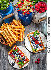 Waffles with fresh collected berry fruit