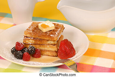 Waffles with fruit and powdered sugar