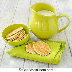 Waffles with jug of milk