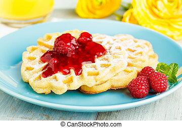 Waffles with red fruit jelly