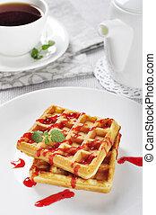 Waffles with strawberry jam
