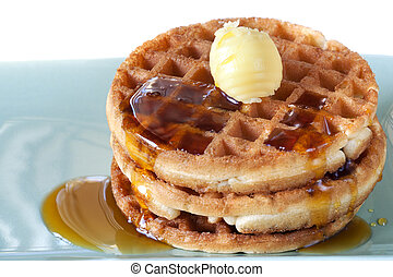 Waffles with Syrup and Butter - Stack of waffles with maple...