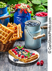 Waffles with whipped cream and berry fruit