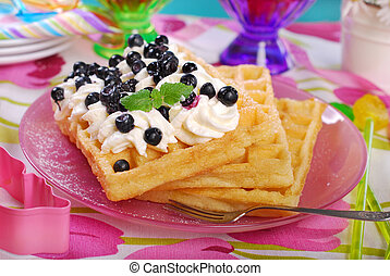 waffles with whipped cream and blueberries - waffles with...
