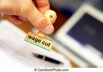 wage cut concept with stamp in office or bureau showing...