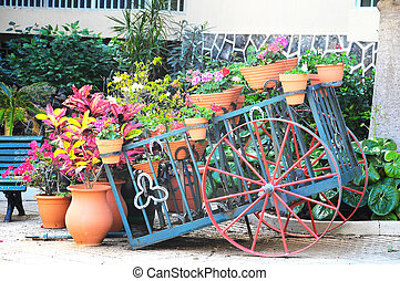 Wagon and Plants - Wagon and Vases with Plants on a Garden