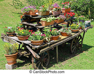 wagon festooned with many pots of flowers