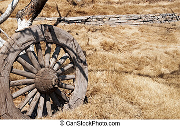 wagon wheel old 3 - A old wagon wheel leaning against a tree...