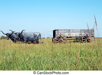 Wagons West - Kansas plains has rustic wooden wagon pulled...