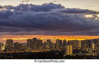 The lights of Waikiki and Honolulu at dusk on the island of Oahu, Hawaii