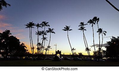 The Waikiki Natatorium War Memorial at dusk which is a war memorial