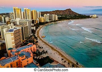 View of Waikiki Beach and Honolulu Skyline at sunset