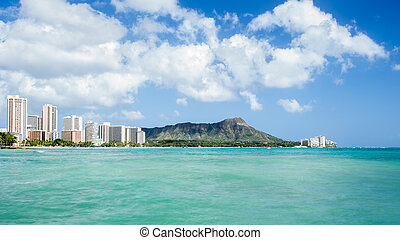 Waikiki beach with Diamond head and hotels background