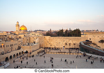 JERUSALEM, ISRAEL - JAN 24: Jewish worshippers pray at the Wailing Wall on Jan 24, 2011 Jerusalem, Israel. The wall is the most sacred site in Judaism outside of the Temple Mount itself.