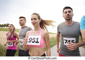 Waist up image of jogging people