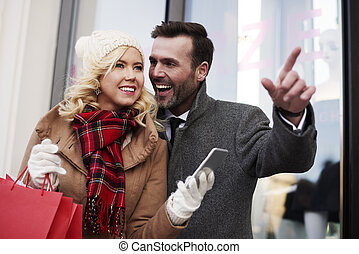 Waist up of adult couple in the city
