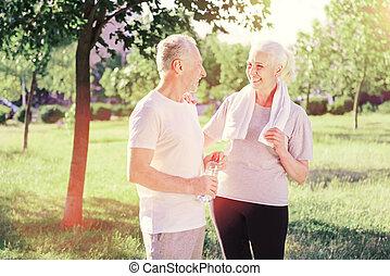 Waist up of delighted elderly friends