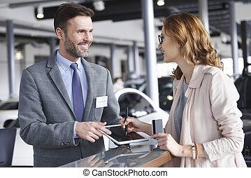 Waist up of salesman with female customer