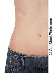 Waistline - Abdomen part of slim woman torso in jeans with...