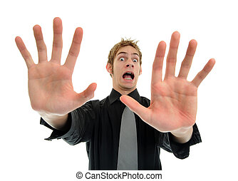 Wait no ah stop - A young man holding his hands out in fear...
