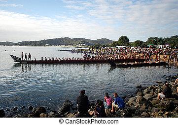 WAITANGI - FEB 6:Maori warriors sail waka boat during Waitangi Day on February 6 2004 in Waitangi NZ.It's a New Zealand public holiday to celebrate the signing of the Treaty of Waitangi in 1840
