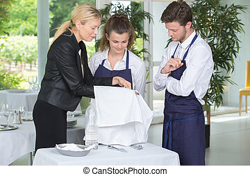 Waiter and waitress in training