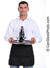 Waiter carrying tray of beer